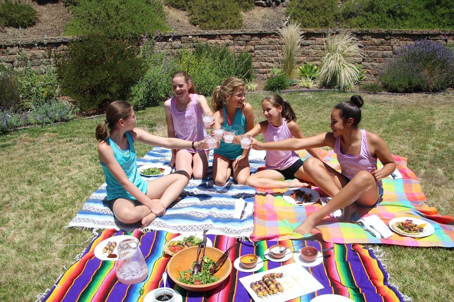 Rising 7th graders raise their lemonade glasses to toast 4 blissful days of yoga, meditation, and plant-based recipes.
